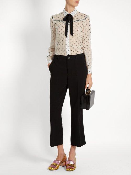 Swallow-print ruffle-trimmed silk blouse by Miu Miu