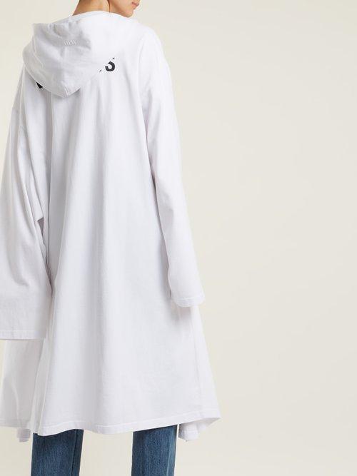 Logo-print oversized cotton hooded sweatshirt by Vetements