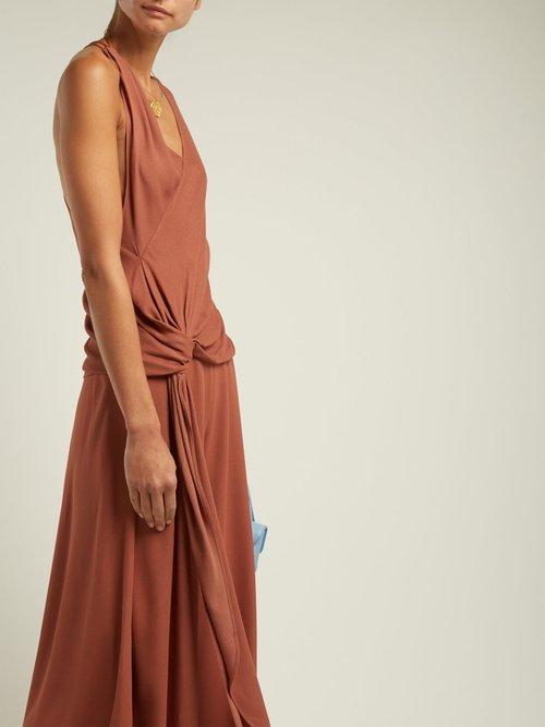 Haut Passo asymmetric drape blouse by Jacquemus