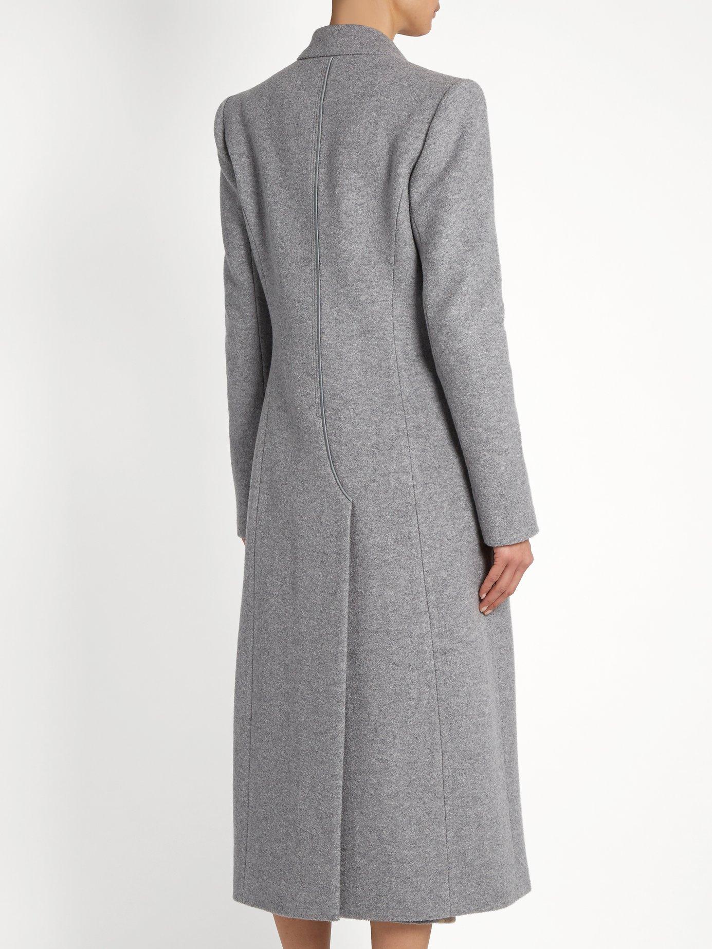 Long Masera peak-lapel wool-blend coat by Carl Kapp
