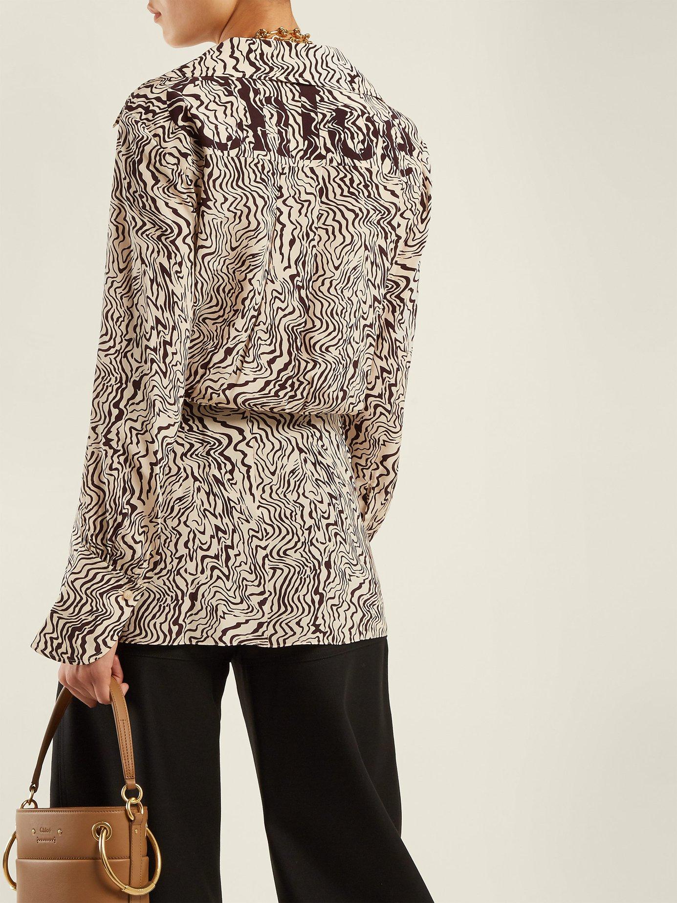 Wave-print V-neck silk blouse by