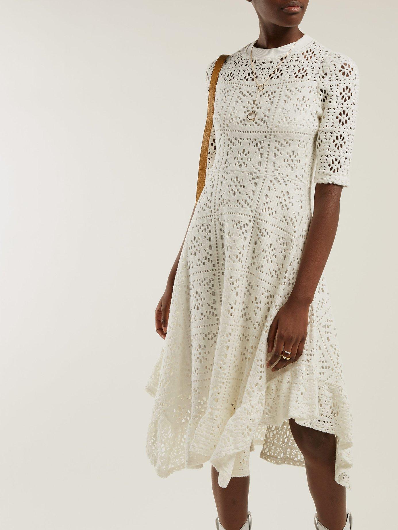 Dipped-hem lace dress by