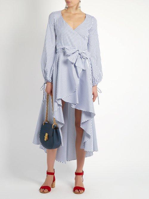 Lena asymmetric-hem cotton wrap dress by Caroline Constas