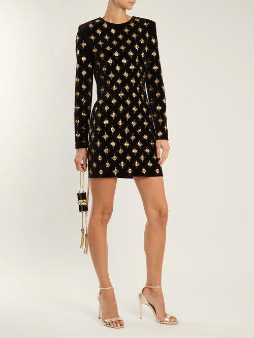 Embellished velvet mini dress by Balmain