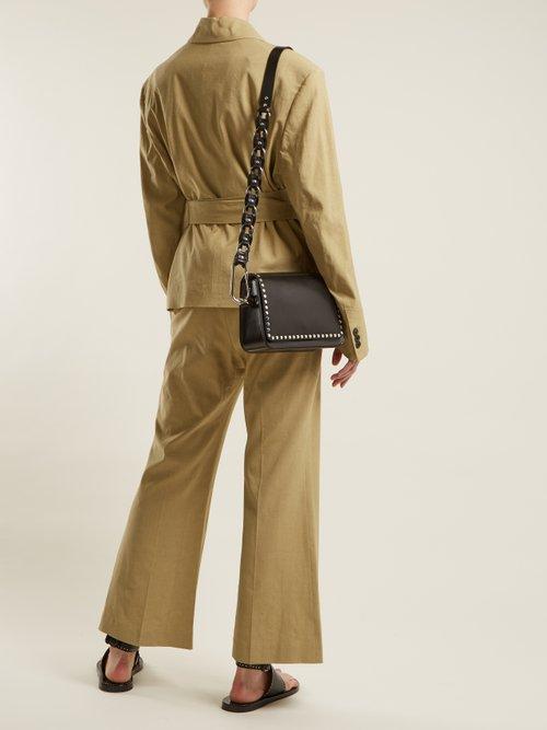 Calibar stud-embellished leather cross-body bag by Isabel Marant