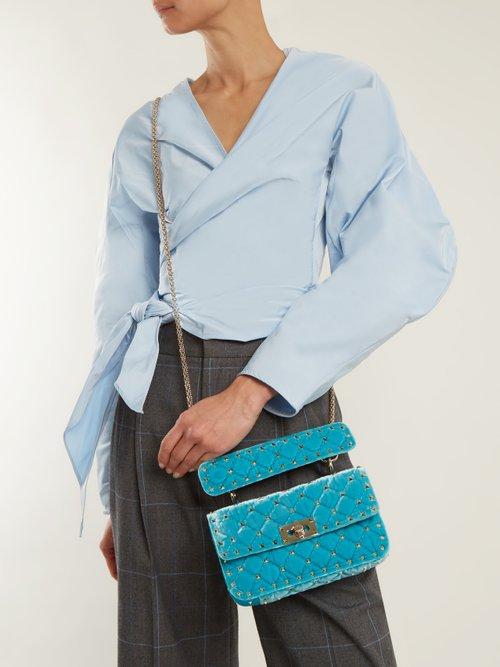 Rockstud Spike small quilted-velvet shoulder bag by Valentino