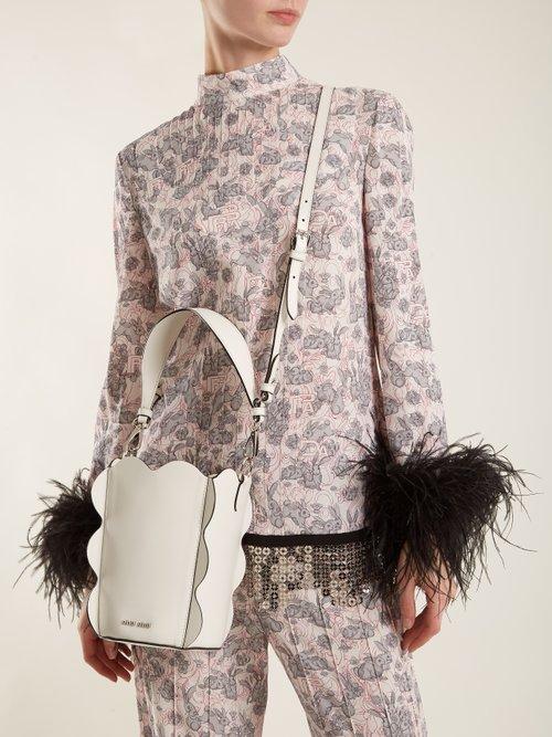 Scallop-edged leather bucket bag by Miu Miu