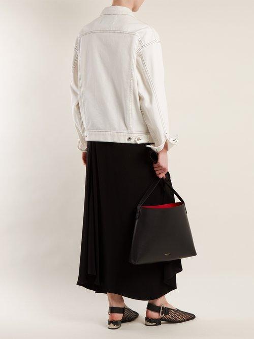 Red-lined leather shoulder bag by Mansur Gavriel