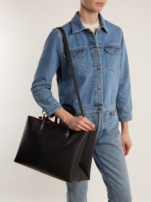 Red-lined folded leather bag by Mansur Gavriel