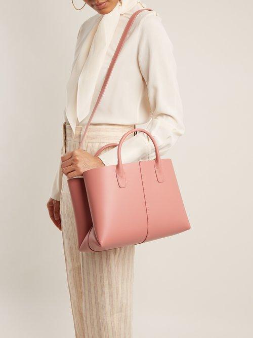 Blush-pink lined folded leather bag by Mansur Gavriel