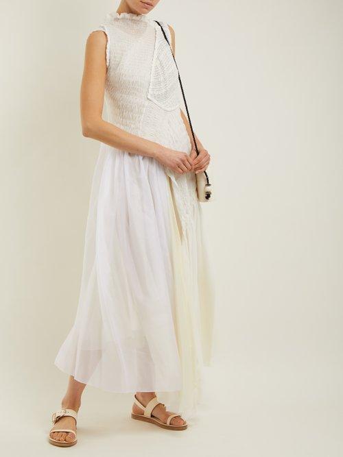 Effervescent asymmetric smocked dress by Jil Sander