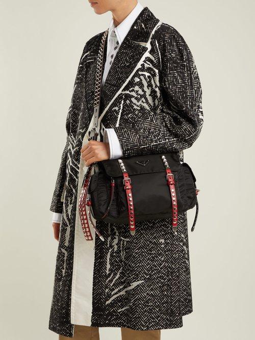 Vela leather trimmed cross-body bag by Prada