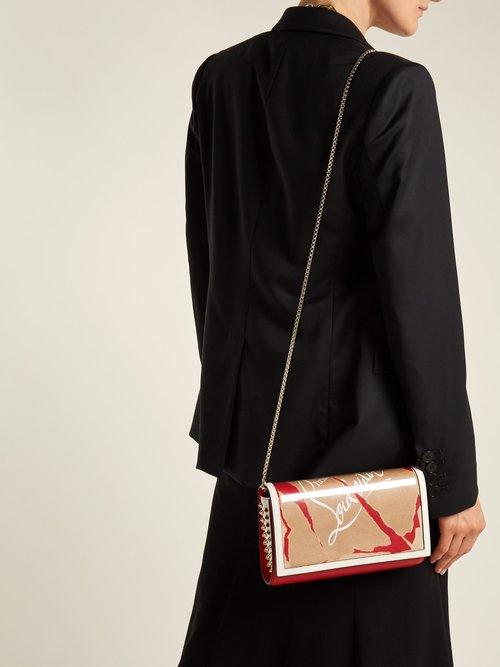 Paloma Kraft Loubi leather and PVC clutch by Christian Louboutin