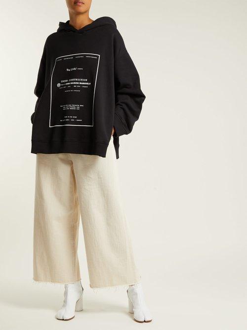 Oversized printed hooded sweatshirt by Mm6 Maison Margiela