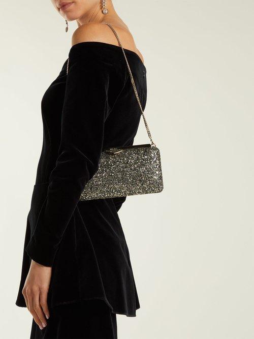 Ellipse glitter-embellished clutch bag by Jimmy Choo