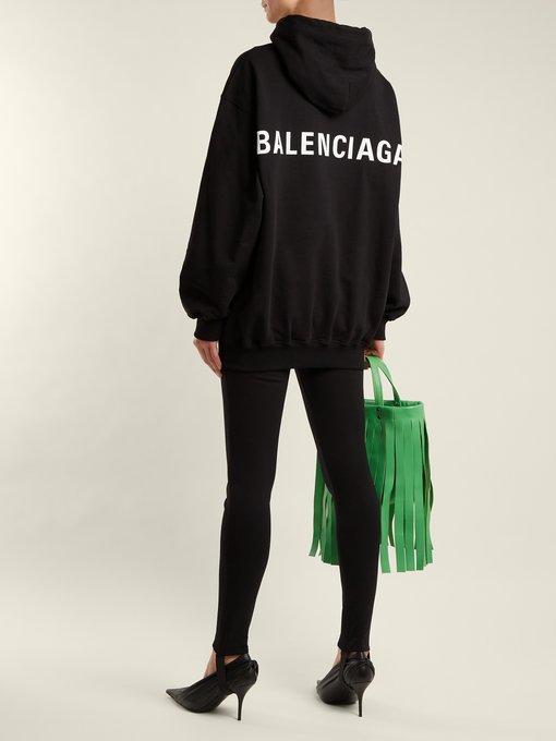 963530c33767 Balenciaga Logo-print cotton hooded sweatshirt. outfit 1204050