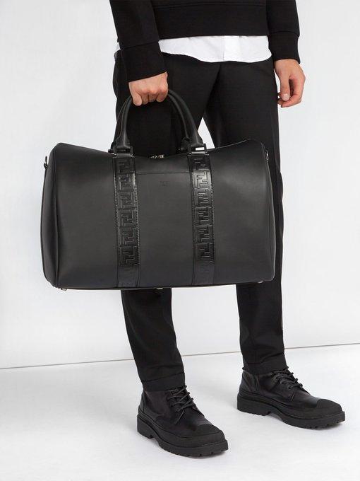 FENDI Leathers FENDI - LOGO EMBOSSED LEATHER HOLDALL - MENS - BLACK