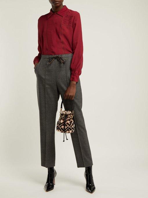 c913c7ba843d Shop Fendi Mon Tresor Mini Logo-Print Shearling Bucket Bag In Pink