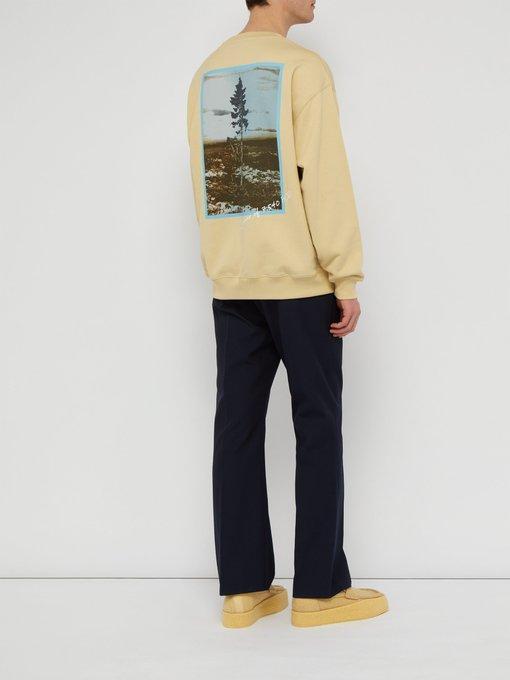 35d2632394c Acne Studios Sweat-shirt en coton de jersey à imprimé Tjikko. outfit 1253864